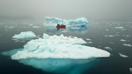 Red fishing boat in front of an iceberg wallpaper