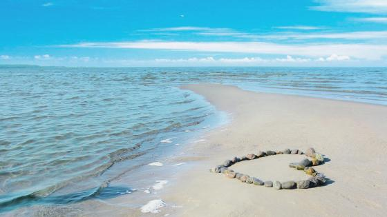 Heart of stones on the beach wallpaper
