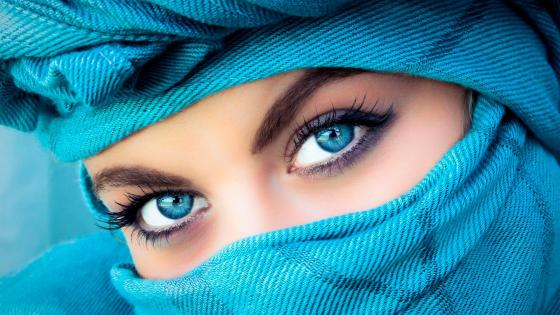 Blue-eyed woman in a blue headscarf wallpaper