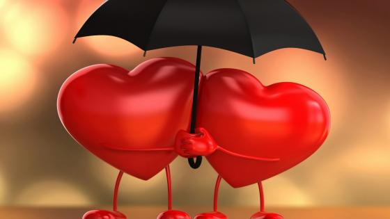 Red hearts under a black umbrella wallpaper