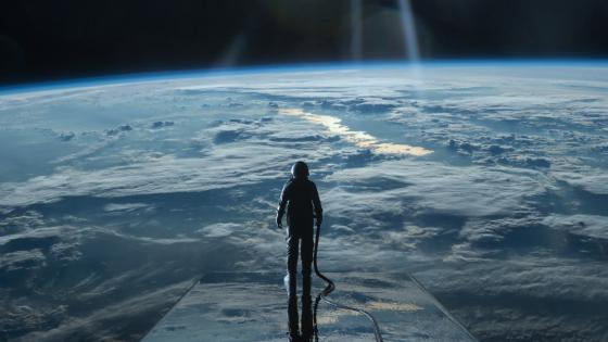 Cosmonaut above the Earth wallpaper