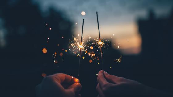 Hands with sparklers wallpaper