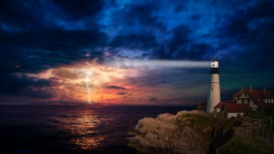 Lightning on the horizon at Portland Head Light wallpaper