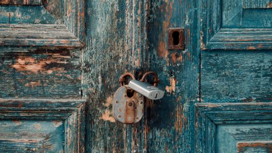 Wooden door with padlock wallpaper
