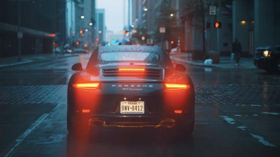 Grey Porsche car on road wallpaper