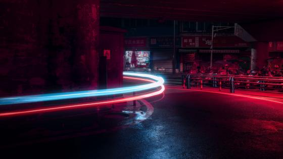 Curving light trails wallpaper