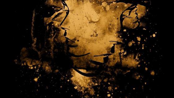 Golden faces in the dark wallpaper