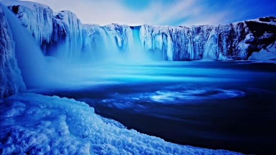 Frozen Godafoss waterfall wallpaper