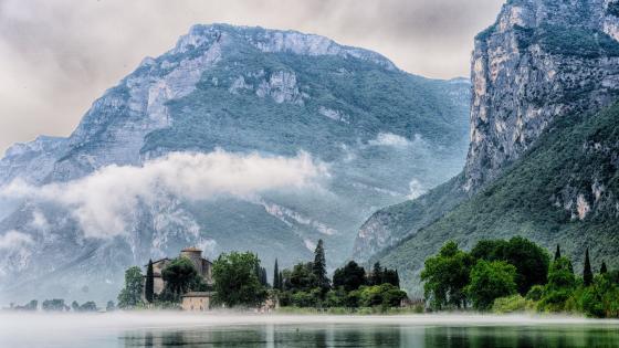 Castle Toblino in the mist wallpaper