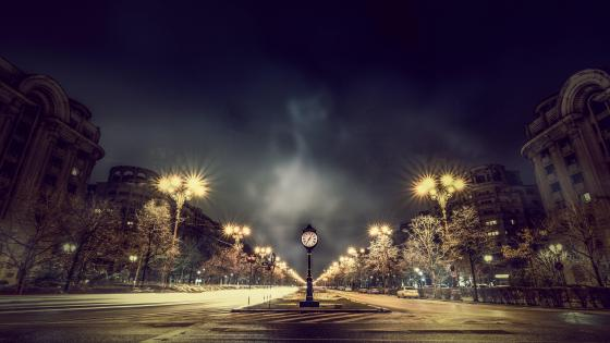 Bucharest street clock by night wallpaper