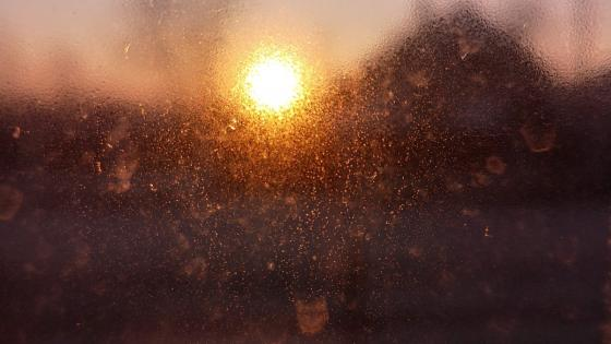 Blurry sunset behind the window wallpaper