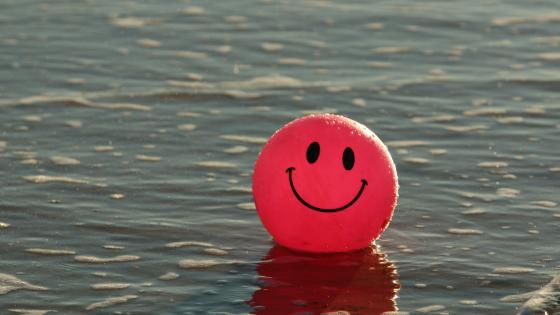Pink Smiley Balloon wallpaper