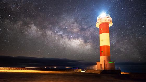 Lighthouse in Starry Sky wallpaper