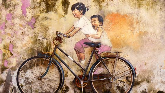 Kids riding a  bicycle - Graffiti Art wallpaper