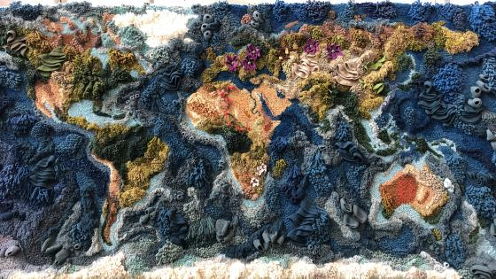 World Map made of woolen yarn at Heathrow Airport wallpaper