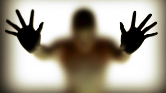 Hands silhouette behind glass wallpaper