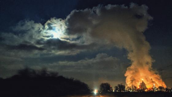 Lit Moon vs Smoldering Power Plant wallpaper