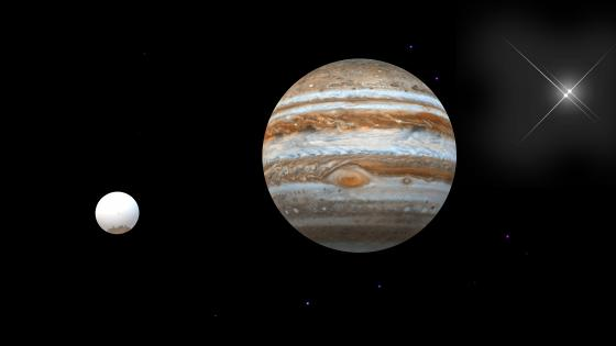 Jupiter and one of its satellites wallpaper