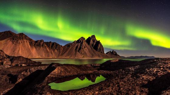Vatnajokull National Park under the polar lights wallpaper