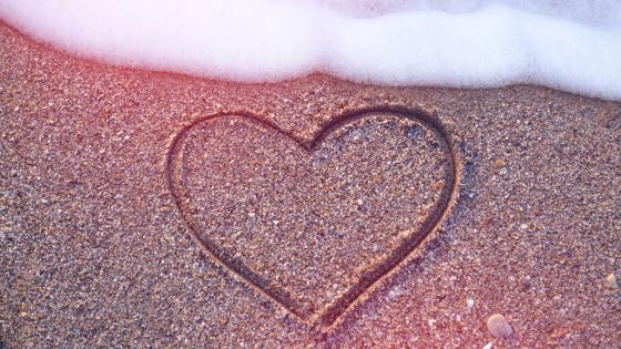 Heart on beach wallpaper