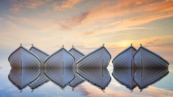 White boats floating on a calm lake wallpaper
