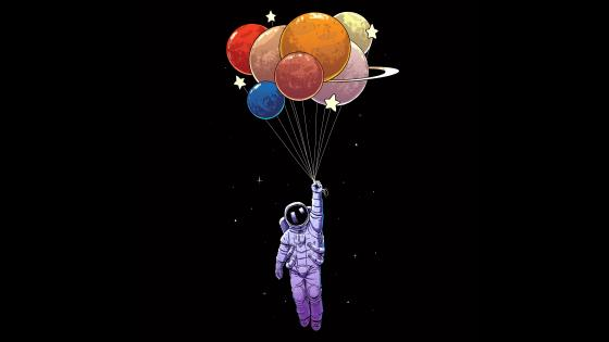 Astronaut Holding Bunch Of Colorful Balloons wallpaper
