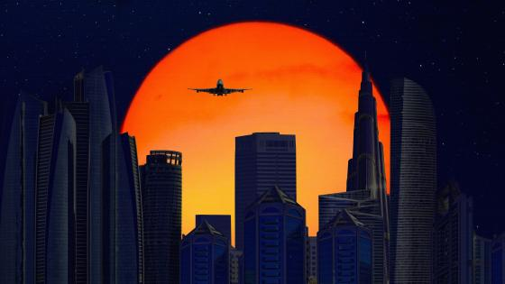 Plane Flying Over The City wallpaper