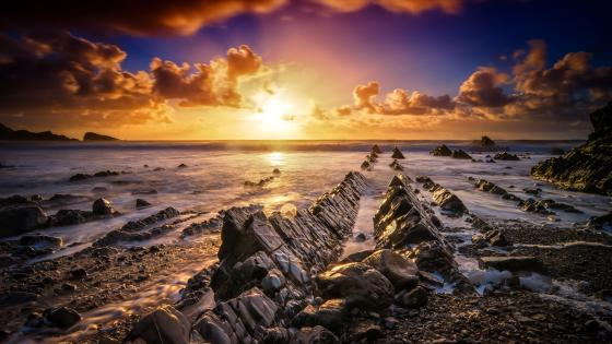 Rock formations in Devon at sunset wallpaper