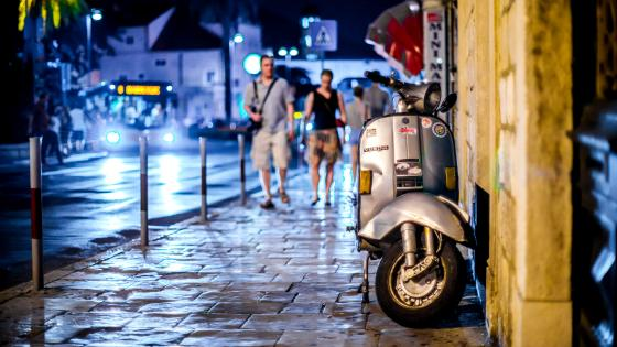 Vespa In The Street At Night wallpaper