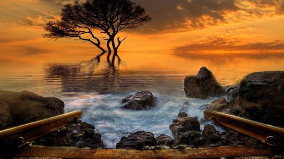 Rails In The Sea At Sunset In A Fantasy Landscape wallpaper
