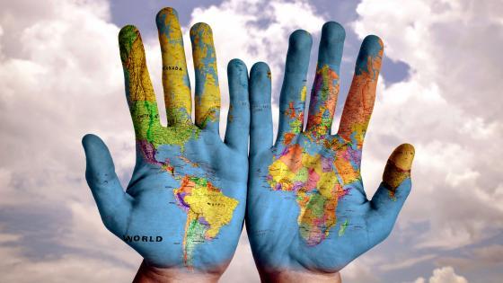 Hands World Map wallpaper