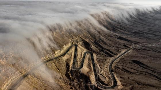 Aerial Photo of Clouds Gliding in the Negev Desert wallpaper