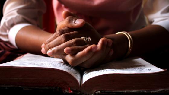 Praying On The Holy Bible wallpaper