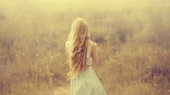 Lone girl in a field wallpaper