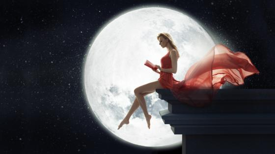 Woman in red dress at full moon wallpaper