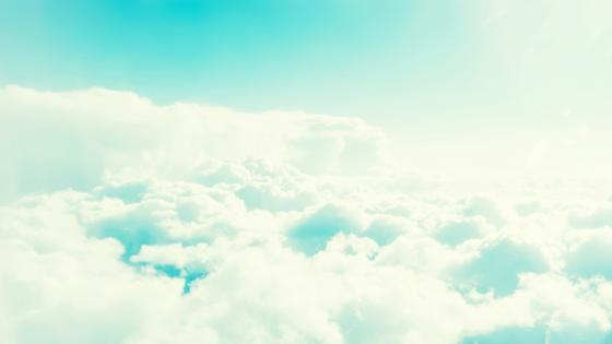 Above the fluffy clouds wallpaper