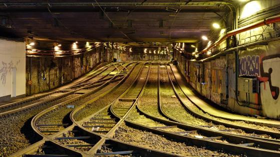 Tracks in the Lemonnier Premetro Station Tunnel wallpaper