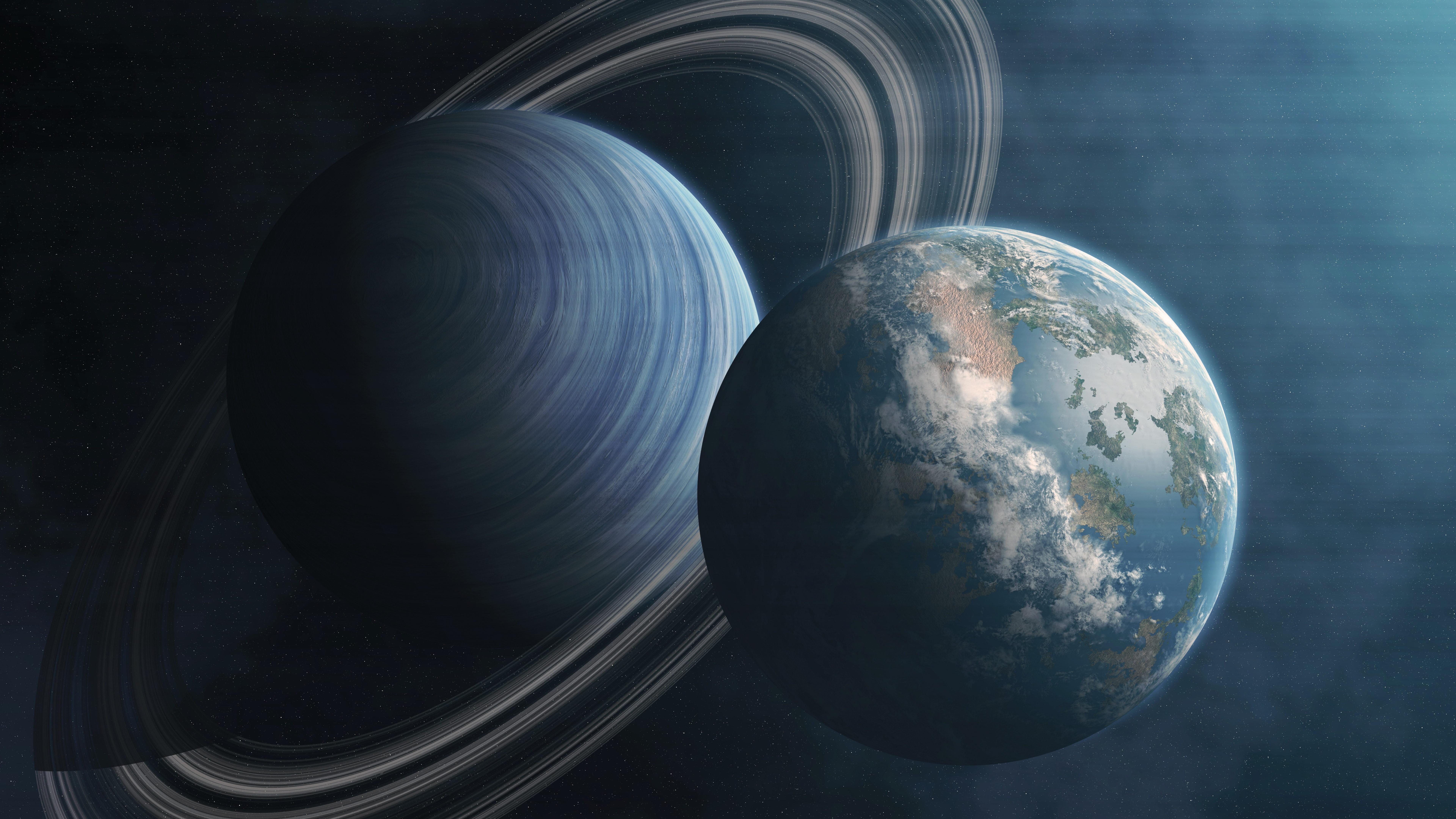 Saturn and Earth wallpaper